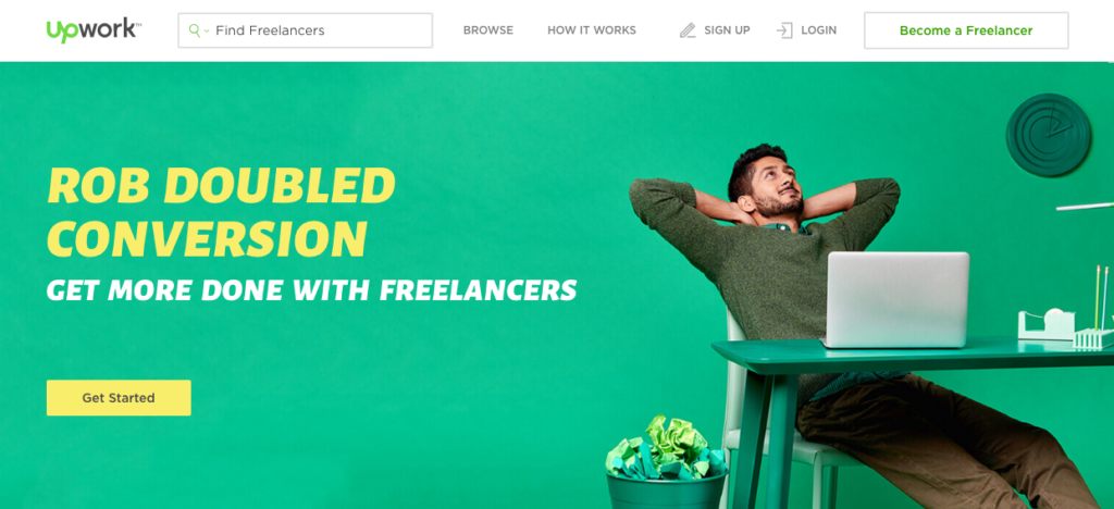 Screen shot of the home page of Upwork. A person sitting behind his computer relaxing and then it says that Rob Doubled Conversion: get more done with freelancers